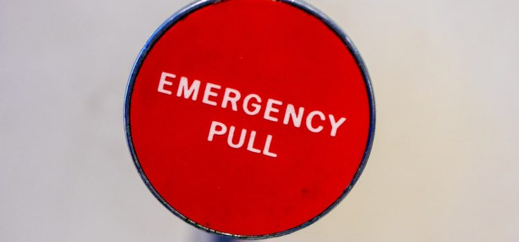 red sign stating emergency