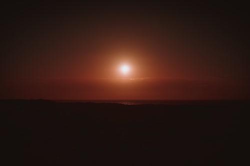 Sun Setting in the Horizon